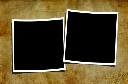 Two blank polaroid photographs on a grungy old and rusty looking background.