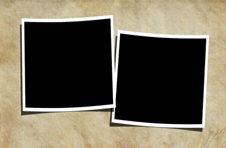 Two blank photographs on a vintage background. photo