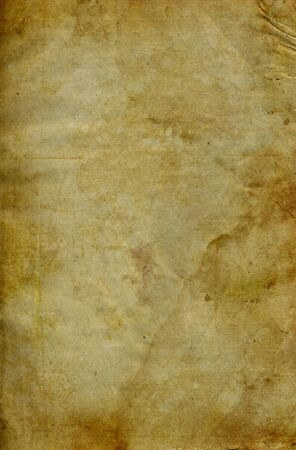 Grunge stained paper background with copy-space. Grainy texture. Stock Photo