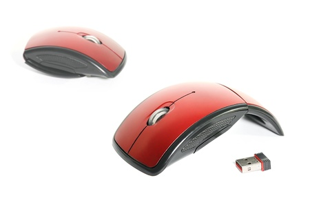 Highly portable, red wireless optical mouse with USB wireless dongle.