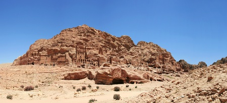 merged: Panaromatic view at Necropolis in Petra canyon, Jordan  Five vertical images merged together  Stock Photo