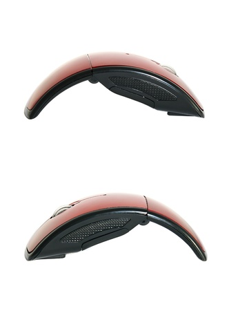 Ergonomic wireless mouse ideal for laptop. Isolated on white background.