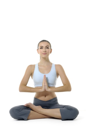 mantra: Young woman doing yoga exercise