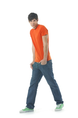 hands in pockets: Young man standing with hands in pockets
