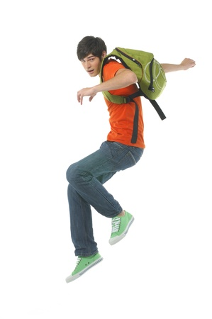 Jumping man with bag on white photo