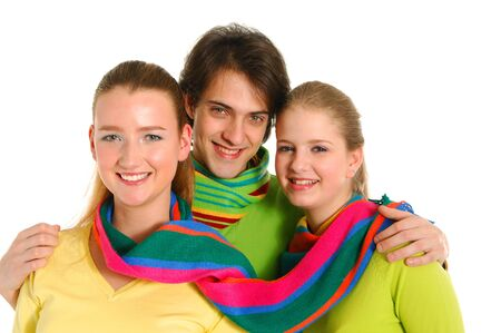 Three young friends embrace over white Stock Photo - 11221948