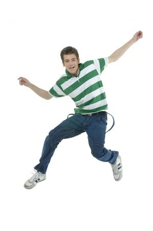 excited people: young man jumping for joy Stock Photo