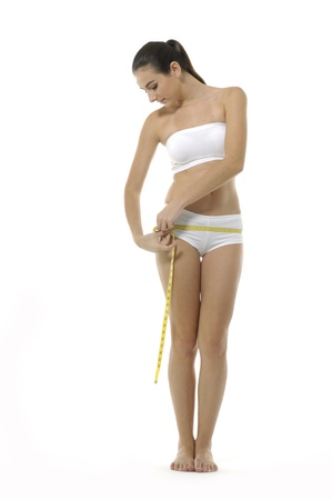 undressed: Woman measuring perfect shape of beautiful thigh. Healthy lifestyles concept Stock Photo