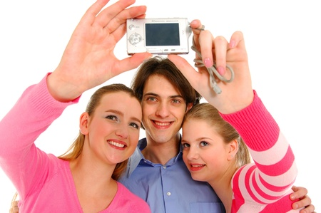 Three  friends taking picture of  themsselves by camera in mobile phone  photo