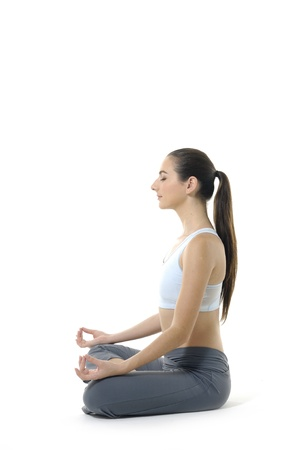 moves: Young woman doing yoga moves or meditating