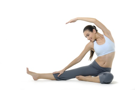 Girl doing yoga on white photo