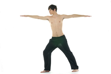 athletic wear: Young man doing yoga in the room