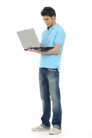 full body shot: Young man holding laptop Stock Photo