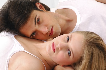 Young couple in a bedroom at home photo