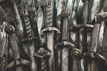 squire: Metal knight swords background. Close up. The concept Knights.