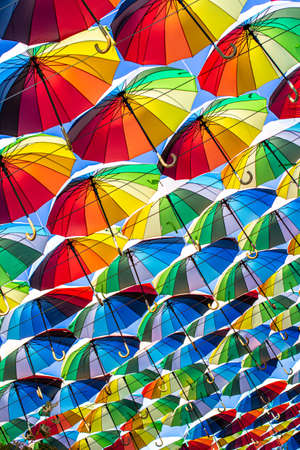 Colorful umbrellas Blue, green, red, rainbow umbrellas background Street with umbrellasin the sky