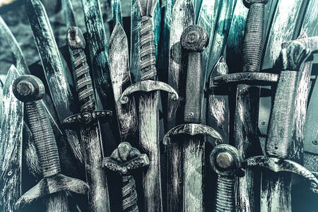 Metal knight swords background. Close up Banco de Imagens