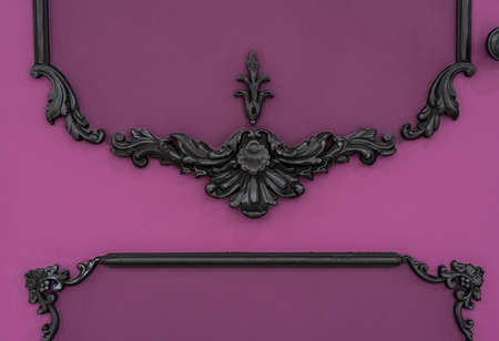 Vintage royal silver horizontal background with black ornaments on a pink wall