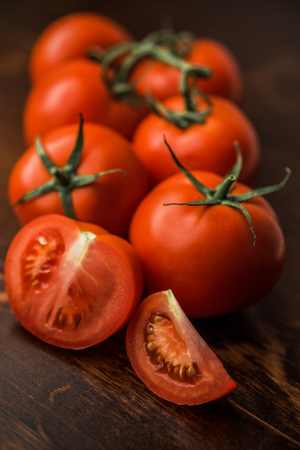 Fresh tomatoes on rustic wooden background