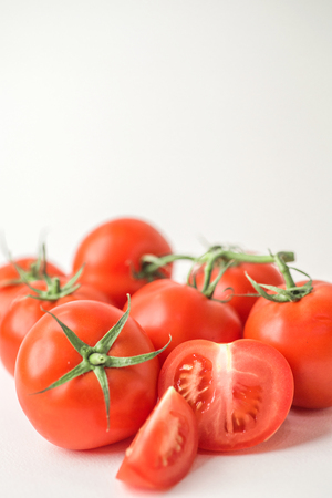 Fresh red tomatoes on white isolated background