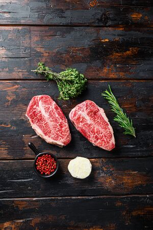 Raw organic meat Top Blade steaks or Australia wagyu oyster blade on old dark wooden background top view.