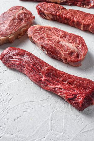 Set of denver, top blade, tri tip steak, machete, flank, bavette London broil marble beef on white background side view close up space view. Foto de archivo