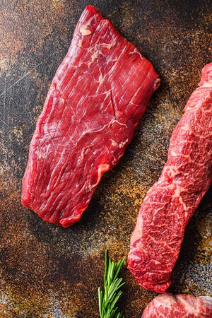 Close up Skirt Steak, Flank steak, cut near denver alternative beef steak a rustic metall background top view layflat.