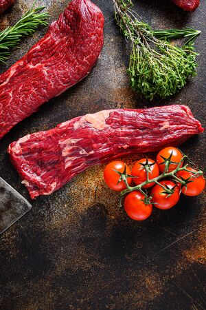Close up machete Steak, Flank steak, cut near denver alternative beef steak a rustic metall background top view layflat. Foto de archivo