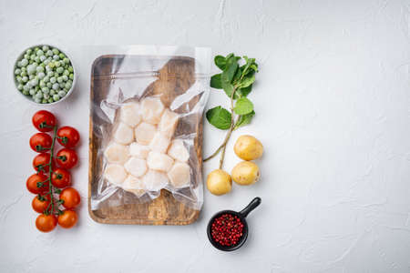 Frozen meat scallops in vacuum package, flat lay, on white textured background with space for text
