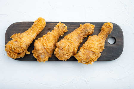 Crispy fried chicken cuts on white background.