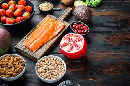 Health food with immune boosting on dark wooden background, with copy space.