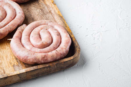 Raw meat sausage set, on white background, with space for text copyspace