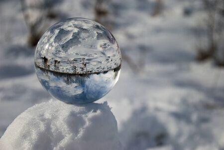 christmas tree ball: Crystal ball in snow Stock Photo