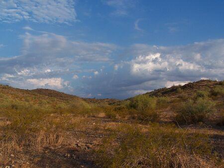 desert cloudy blue sky Stock Photo