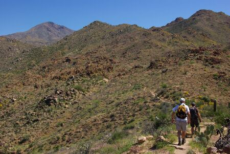 two hikers in desert Stock Photo