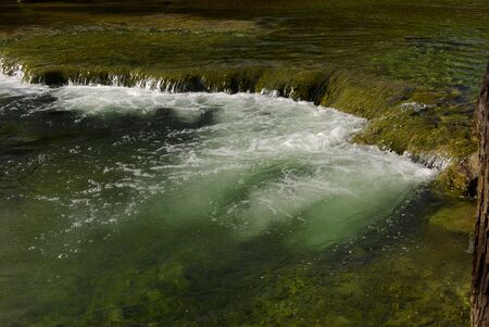 small fall in clear stream