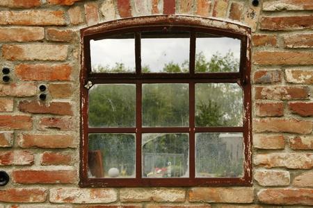 rusty old cow barn windows with tilt sash photo