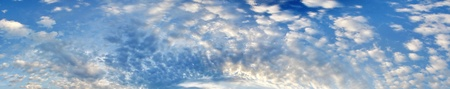 white clouds against blue sky as background
