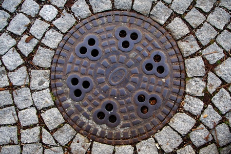 a manhole cover in the city of Memmingen  photo