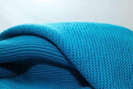a self-knitted wool blanket made of blue cotton