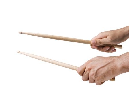 Male hands holding drum sticks isolated on white