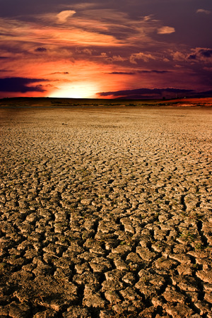 Dry cracked land and the sunset