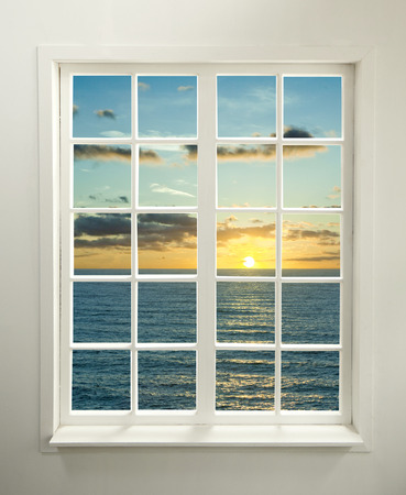 Modern residential window with sunset over sea and clouds (includes clipping path) Zdjęcie Seryjne