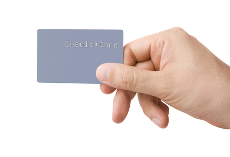 Male hand holding credit card isolated on white Zdjęcie Seryjne
