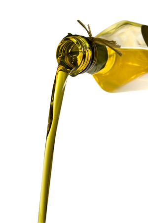 Olive oil poured from an original bottle isolated on white background with clipping path
