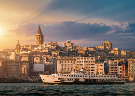 Iconic view of Istanbul with Galata Tower and the ferry