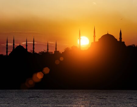 Hagia Sophia and The Blue Mosque during sunset in Istanbul Turkey