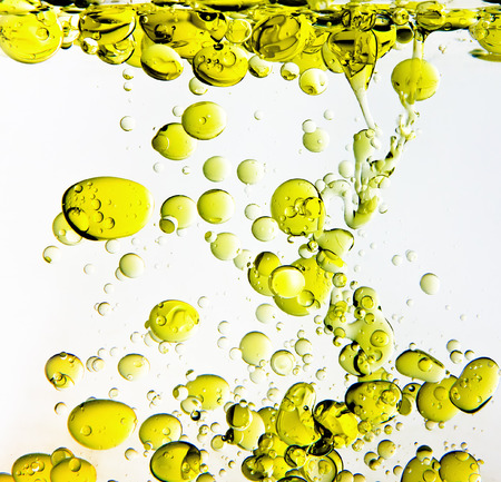 Olive oil bubbles in water