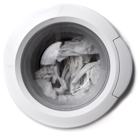 Close-up of a washing machine cover with clothes in