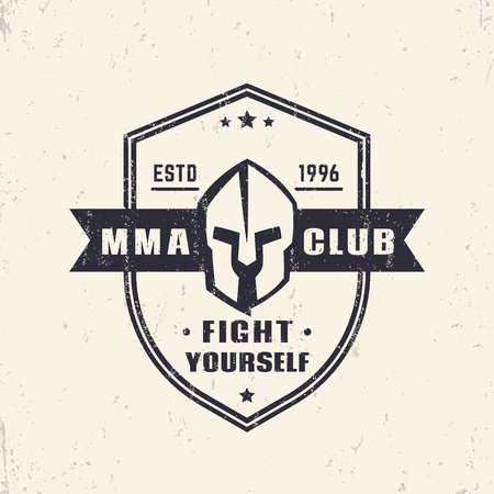spartan: MMA Club vintage shield shape emblem, logo with spartan helmet Stock Photo